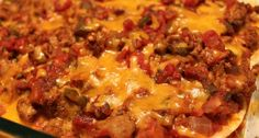 Easy Taco Casserole Recipe ! 1 7oz bag Nacho Cheese Doritos, crushed 1 lb hamburger, browned 1 pkg taco seasoning, mixed according to directions 1 (8 oz) pkg shredded Cheddar cheese 1 (8 oz.) pkg. shredded Mozzarella cheese Shredded Lettuce Sliced tomato Layer ingredients in 9 x 13 pan as listed - crushed chips, meat & seasonings, 2/3 of cheese, lettuce, tomato, remaining cheese. Bake at 350 degrees for 15 minutes #Recipes #Appetizers