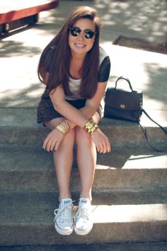 Edgy outfit! Leopard skirt, classic chucks, leather sleeved tee vintage bold gold statement jewelry  & coach legacy bag.
