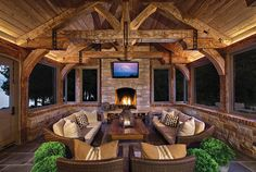 "Rustic Sun Porch with stone fireplace from ""Enclosed Sun Porches"""