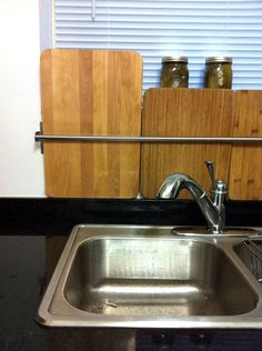 Ikea towel rack as a cutting board organizer! OMG, I can't stand how we store our boards now, this is my answer!