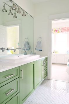 All the details on the kids bath (green cabinets, long sink, wall mounted faucets)