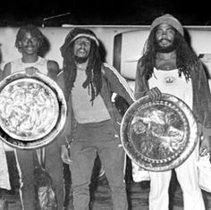 Bob marley with jacob killer miller and junior marvin at the airport