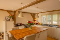 Kitchen diner with oak beams in oak frame house in Cotswolds Oak Frame House, Leather Bar Stools, Timber House, Dream House Exterior, Bar Areas, Beams, House Design, House Styles, Kitchen
