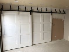 Double barn door being installed. Wait to see the final product.   American Construction & Renovation 480-404-3033 AmericanConstructed.com #AmericanConstructed @AmericanConstructed