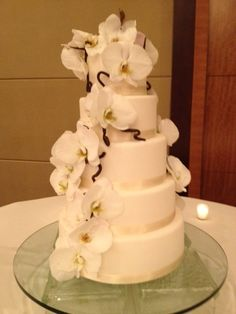 Tiramisu Cake, Sweetened Mascarpone with Chocolate Covered Crispies and Vanilla Cake, Lemon Cream with Fresh Raspberries... made for a 6/2 wedding at Four Seasons Hotel Denver in downtown Denver. Delicious!