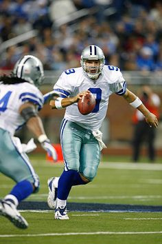 Quarterback Tony Romo of the Dallas Cowboys looks to pass against the Detroit Lions on December 9 2007 at Ford Field in Detroit Michigan Cowboys Vs, Dallas Cowboys, Detroit Michigan, Detroit Lions, Stock Pictures, Stock Photos, Ford Field, Tony Romo, Royalty Free Photos