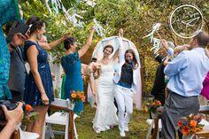 Seattle wedding photography   Amelia Soper Wedding Photographer, backyard, couple, brides, same sex, lesbian wedding, LGBT, rainboots, onelove, ceremony, exit, streamers