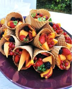 Use ice cream cones to hold fruit salad. Makes individual servings and a great presentation! You can even leave a can of whipped cream for guests to use on top.