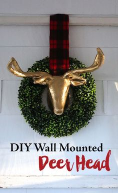 DIY Wall mounted faux deer head in a boxwood wreath. Easy christmas decor idea to make your christmas decorations more farmhouse style.