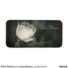iPhone SE/5/5s/5c Pouch. Beautiful flower of a white wild rose (dogrose). Nature photography. White flower in the night. Love and tenderness. Dark green background. Elegant feminine style. Good gift for women and girls. You can add your name or custom text. Also you can delete text at all. #white #dogrose #rose #wildrose #flower #dark #night #green #text #name #black #love #elegant #nature #feminine #customized #personalized #POD #giftideas #zazzle #gifts #unique #photo #photography…