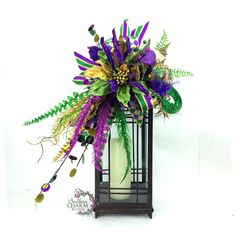 Wreaths with a southern charm Mardi Gras Lantern Swag for your table or coat. This swag works on a lantern from 18 high as Mardi Gras Centerpieces, Mardi Gras Decorations, Holiday Decorations, Mardi Gras Food, Mardi Gras Party, Holiday Wreaths, Mesh Wreaths, Holiday Crafts, Holiday Ideas