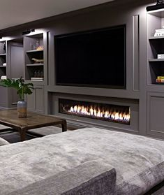 When it comes to outfitting the ground floor in your home, a basement fireplace will up the ante. We're talking instant warmth and ambiance. Here are eight basement fireplace ideas to inspire your decor. Basement Living Rooms, Basement Fireplace, Modern Basement, Fireplace Design, Fireplace Ideas, Basement Ceilings, Modern Tv Room, Cozy Basement, Low Ceilings