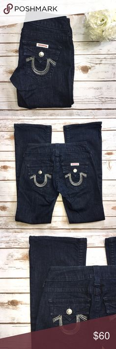 True Religion Embellished Jeans ☀️ Excellent used condition-no signs of wear. Dark wash jeans with Embellished back pockets as well as small front pocket. Fabric content 98% cotton and 2% Spandex  Measurements approximately:                                              🍍Waist: 28 inches 🍍Inseam: 31 inches 🍍Front Rise: 8 inches  🍍Back Rise: 11 inches True Religion Jeans