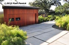 cool idea for a driveway, concrete pads with gravel 'grout' so rain water can soak into the ground
