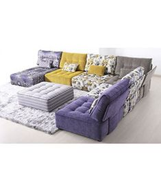 Are you trying to create a beautiful colour display in your #living #room? This #sofaset will serve your purpose rightly as it consists of various shades like violet, yellow, grey and even flowery patterns. Alice modular #sofa comes along with a chase as well.