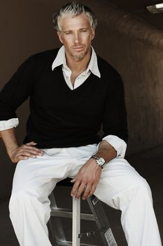 I love men in sweaters......ok....he is seiously hot and who cares about the sweater...hahahah..hehe