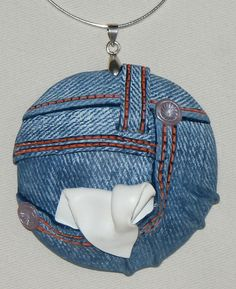 Polymer clay faux denim pendant by Sylvie Peraud of Fimo Maniguette. She teaches similar techniques at workshops and on CraftArtEdu.