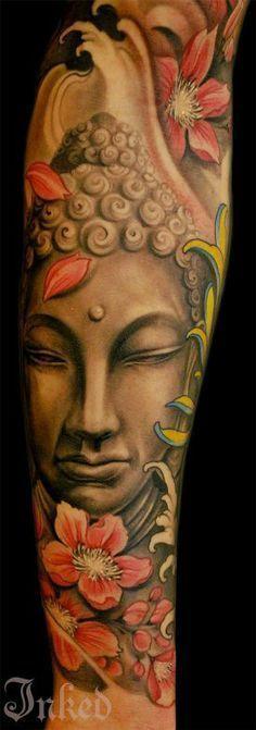 Colorful Buddha tattoo on sleeve