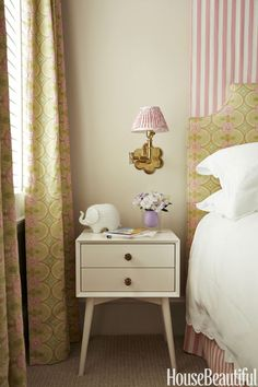 In the daughter's room, Soane Britain's Petal swing-arm light glows above a West Elm side table. The walls are painted in Benjamin Moore's Sail Cloth.