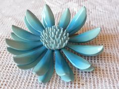vintage enamel pin, aqua pin brooch, flower shape, very pretty. $14.00, via Etsy.