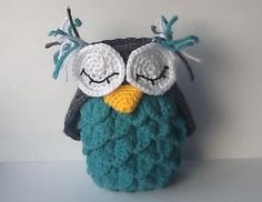 The body of this crochet owl holder (for stationary, crochet hooks and what not) is adapted from a crocodile stitch purse pattern on Bernat's website, and the rest is my own creation. It can easily be modified into a stuffed owl if you sew the top together. Enjoy.