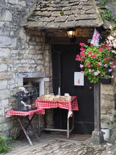 I love to see this, just put your money in the trust box and buy your cake, Castle Combe, Wiltshire, England