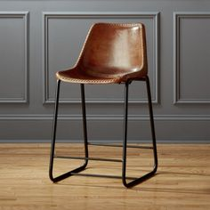 """Shop roadhouse 24"""" leather counter stool.   Handmade leather composite with natural hide tones and markings saddles a contoured seat edged with a handsewn whipstitch and brass-painted rivets."""