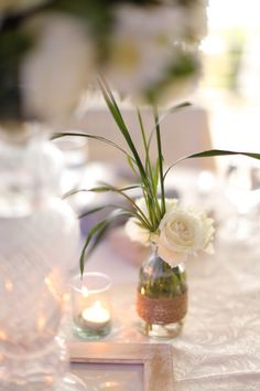 A very simple arrangement using green lace with white roses for the guest's table with clear glass. www.sergeigonia.com