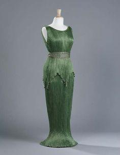 "Mariano Fortuny, ""Delphos"" Pleated Green Silk Evening Dress, c. 1910-1920."