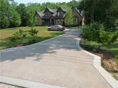 Exposed Aggregate Driveway with concrete band. Exposed Aggregate Driveway, Concrete Driveways, Walkways, Exposed Concrete, Polished Concrete, Stone Driveway, Driveway Design, Driveway Ideas, Driveway Border