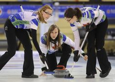Skip Rachel Homan delivers a rock as teammates Alison Kreviazuk (left) and Lisa Weagle prepare to sweep during the finals of the Ontario Scotties Tournament of Hearts at the K-W Granite Club on Sunday.