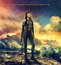 """The Victor Banner for """"The Hunger Games: Catching Fire"""" has added District 7 tribute Johanna Mason (Jena Malone), who is pictured with her trusty ax, ready to inflict some serious damage."""