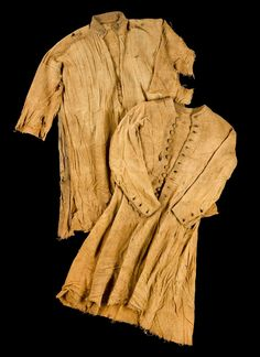 Thigh-length undershirt of brown wool, front opening closed by a single button on the collar, one of a collection of finds from a body ...