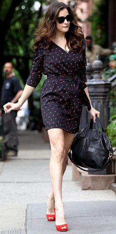 Look of the Day › June 25, 2011 WHAT SHE WORE Tyler exited her N.Y.C. apartment in a silk DKNY print dress and red Christian Louboutin peep-toes.