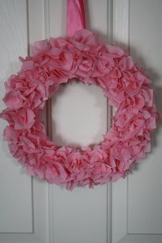 I started out with a $1 wreath form, and wrapped it with crepe paper. Then I cut the crepe paper into strips, lots and lots of str...