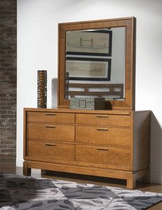 The Bainbridge dresser and mirror combines homespun practicality with sophisticated décor. The wide profile dresser has 6 sunken drawers, 2 smaller drawers with keep jewelry and accessories neatly organized while 4 larger drawers store clothing. The sunken framed mirror and dresser come in an exotic cherry finish. Rent this dresser/mirror combo for your contemporary guest or master bedroom.