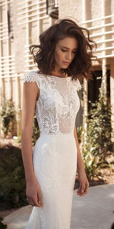 This collection embodies those feelings of femininity and power, through the bohemian glamour style, features romantic wedding dresses in relaxed silhouettes and two-piece ensembles puffy short sleeves Wedding Dresses 2018, Bohemian Wedding Dresses, Bridal Dresses, Relaxed Wedding Dress, Bohemian Hair, Bohemian Weddings, Lace Weddings, Boho Wedding, Bridesmaid Dresses