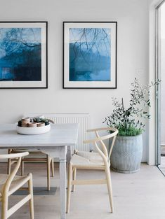 wishbone chairs + white-washed table + blue + floor planter + bowl of succulents