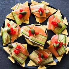 Thin slices of rye bread, spread with cream cheese and topped with smoked salmon trout, cucumber ribbons and salmon roe is about as classy as it gets.