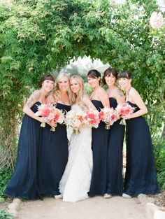 navy bridesmaid dresses and coral bouquets Photography by lanedittoe.com |  Event Planning by amberweir.com |  Floral Design by ninakincaiddesigns.blogspot.com |  Read more - http://www.stylemepretty.com/2013/06/10/heartstone-ranch-wedding-from-amber-weir-event-design-lane-dittoe/