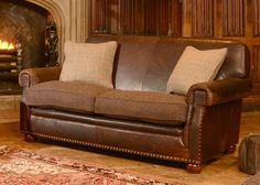 Tetrad Harris Tweed Stornoway Sofa Collection from George Tannahill & Sons - This is Harris Tweed? Wow stunning leather sofa by Tetrad. Find it online at tannahillfurniture.co.uk