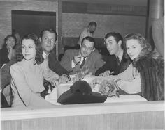 Frances Dee & hubby Joel McCrea sitting opposite of Barbara Stanwyck & hubby Robert Taylor at a special event