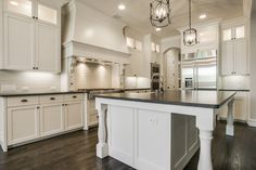 Traditional Kitchen with Undermount sink, Simple granite counters, Crown molding, L-shaped, High ceiling, Hardwood floors
