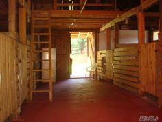 Interior of rustic barn with hayloft