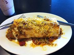 """KING'S CHEF DINER -- COLORADO SPRINGS, COLORADO.  The outside of is a purple castle.  On the inside, they are serving up their breakfast burrito, dubbed the """"tastiest breakfast in Colorado"""" by Food Network Magazine."""