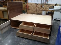 Custom platform bed with storage made of walnut and appleply. www.independentwoodworks.com