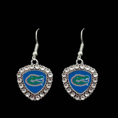 Crest Crystal Bezel Earrings University of Florida F51203-UF Fashionable University of Florida team jewelry. Earring wires are sterling plated over stainless steel. Dangling charm featuring crystals surrounding Florida logo made of silver toned metal findings made of tarnish protected pewter and zinc. Hypoallergenic. Lead, nickel, and cadmium safe.