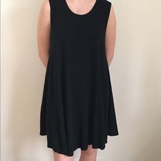 Black Flowy Brandy Melville Dress Wonderful condition! One size fits all from Brandy. Sleeveless. Super soft cotton. East to dress up or down. Thicker cotton but still comfortable to wear in hot weather. Cotton but never seemed to wrinkle easily! Purchased at the Brandy Melville in Italy. Brandy Melville Dresses