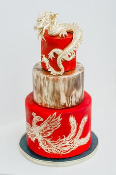 Perfect Hand Sculpted Golden Dragon On Top Of A Red And Golden Wedding Cake With A  Hand Painted Phoenix. Photo Credit: Mango Studios