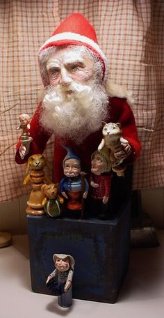 """This Santa Jack is in a wood box, sturdy and he has seven hand made toys, all waxed.  I love his face, great expression.  He is 14 1/2"""" tall and 4 1/2"""" wide. 4/21/15   (decamp)"""